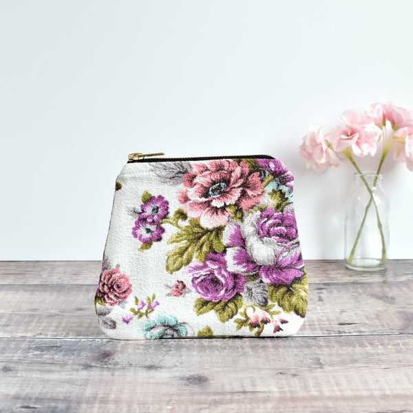 Zip purse, makeup bag made from white barkcloth pink and purple vintage floral fabric handmade by Stitch Galore