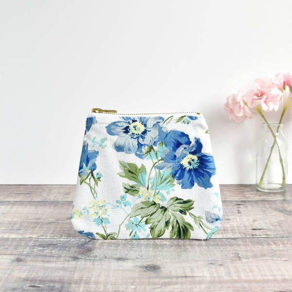 Zip purse, makeup bag made from white blue floral vintage fabric handmade by Stitch Galore