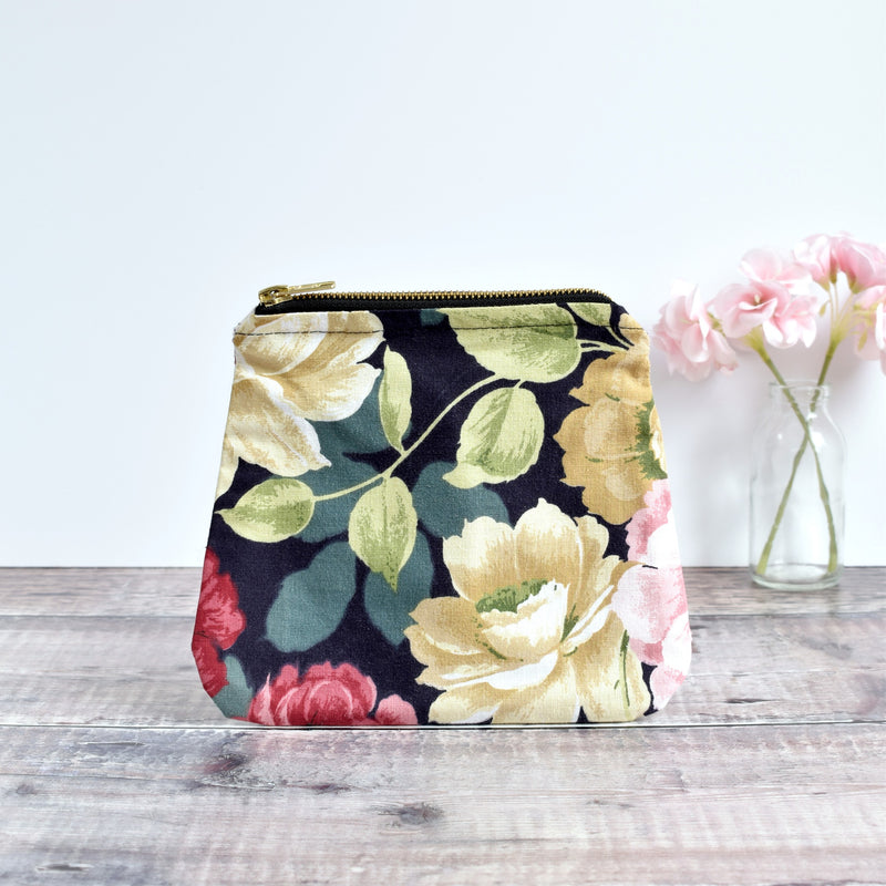 Zip pouch, makeup bag made from  black floral vintage fabric handmade by Stitch Galore