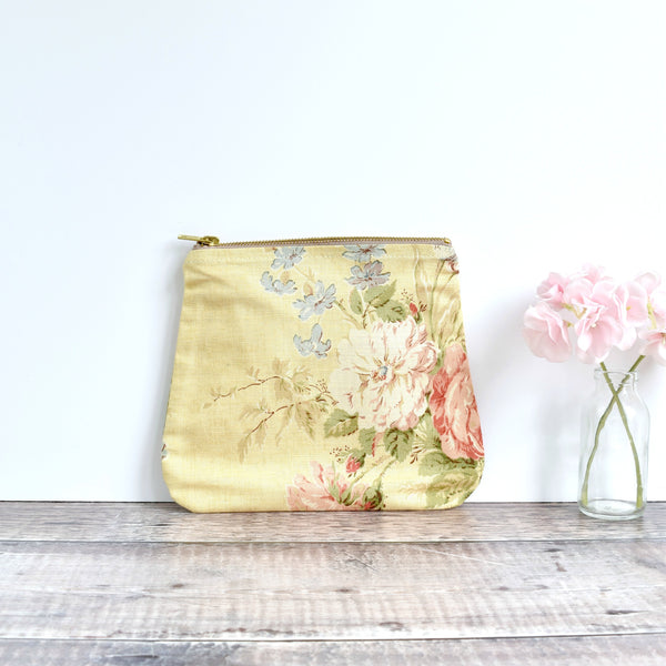 Zipper pouch, cosmetic bag made from yellow floral vintage fabric handmade by Stitch Galore