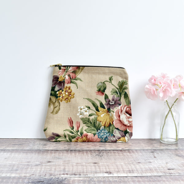 Zipper pouch, cosmetic bag made from beige Sanderson floral vintage fabric handmade by Stitch Galore
