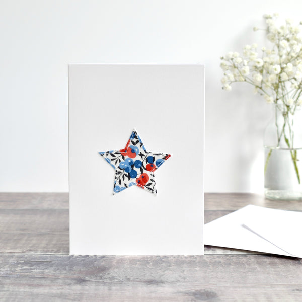 Liberty fabric star card with red and blue berries handmade by Stitch Galore
