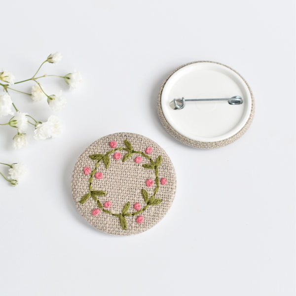 Embroidered pink flower wreath pin badge