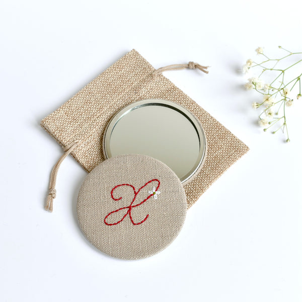 Initial X embroidered monogram mirror handmade by Stitch Galore
