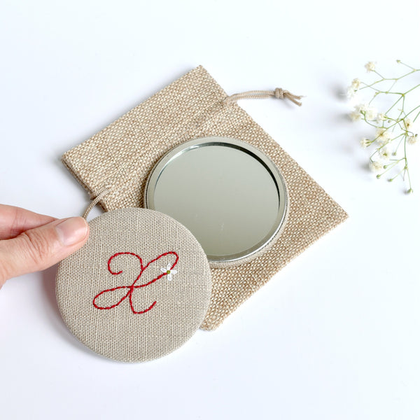 Letter X embroidered monogram mirror handmade by Stitch Galore