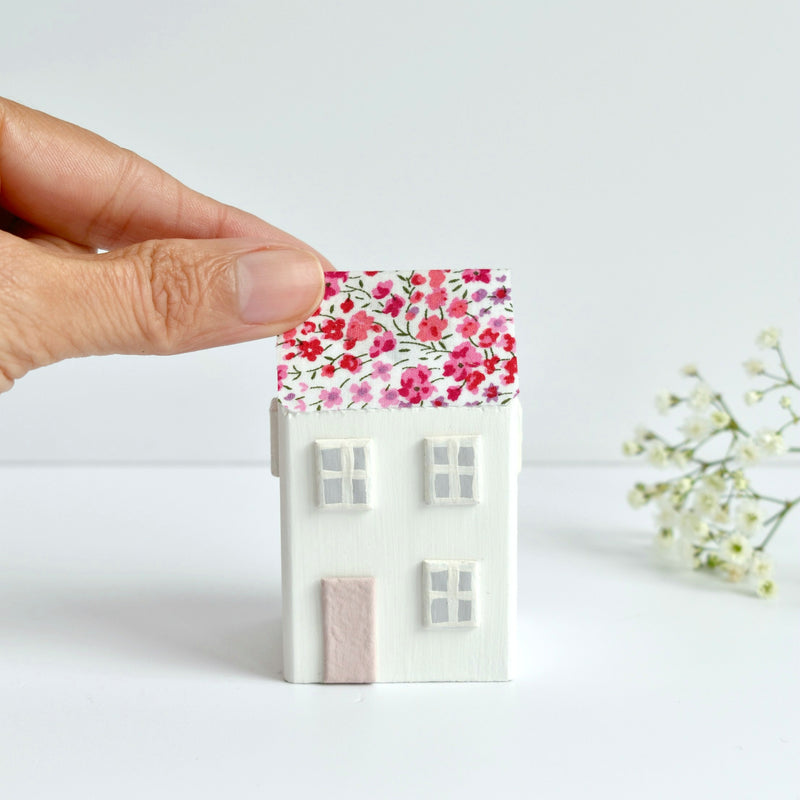 little wooden house ornament with pink Liberty of London floral fabric handmade by stitch galore
