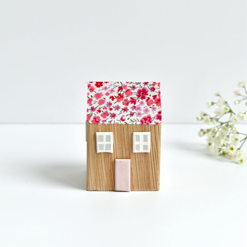 tiny wooden house ornament with pink Phoebe Liberty fabric handmade by stitch galore