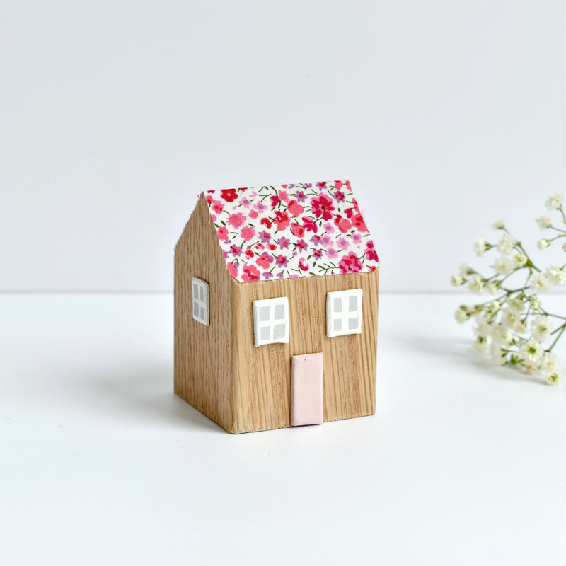 Miniature wooden house ornament with pink Phoebe Liberty fabric handmade by stitch galore