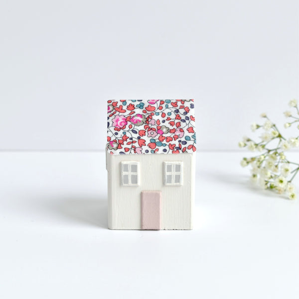 tiny wooden house ornament with pink Eloise Liberty fabric handmade by stitch galore