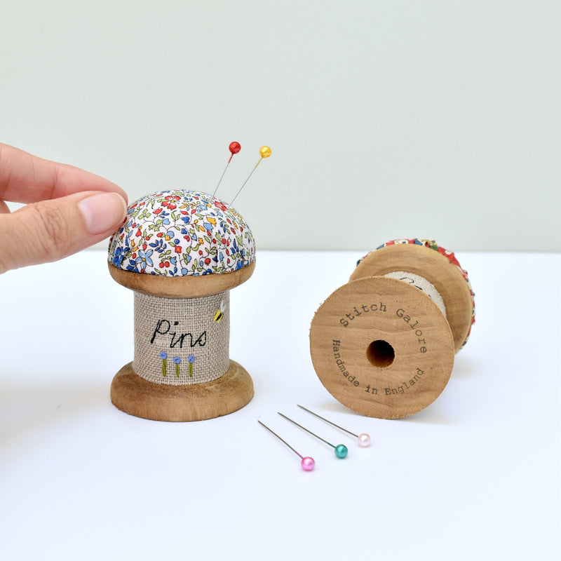 Embroidered pincushion, pin holder made using a wooden spool and Liberty fabric handmade by Stitch Galore