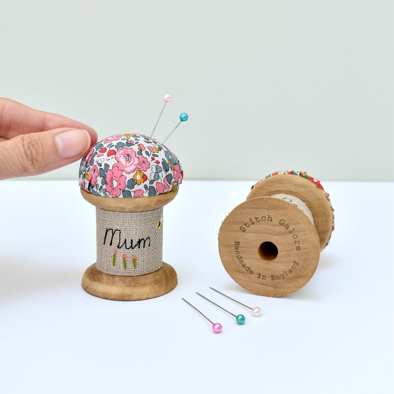Embroidered personalised Mum pincushion, pin holder made using a wooden spool and Liberty fabric handmade by Stitch Galore