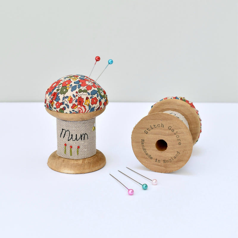 Pincushion for Mum, personalised sewing gift made with a wooden cotton reel and Liberty fabric handmade by Stitch Galore