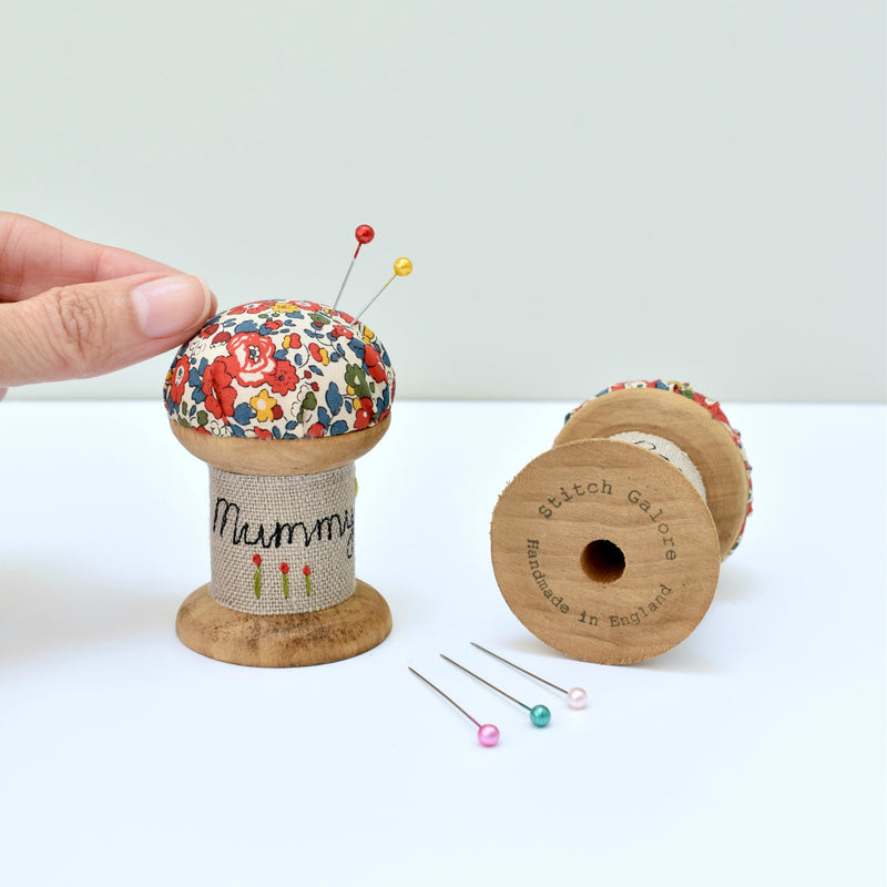 Embroidered personalised Mummy pincushion, pin holder made using a wooden spool and Liberty fabric handmade by Stitch Galore