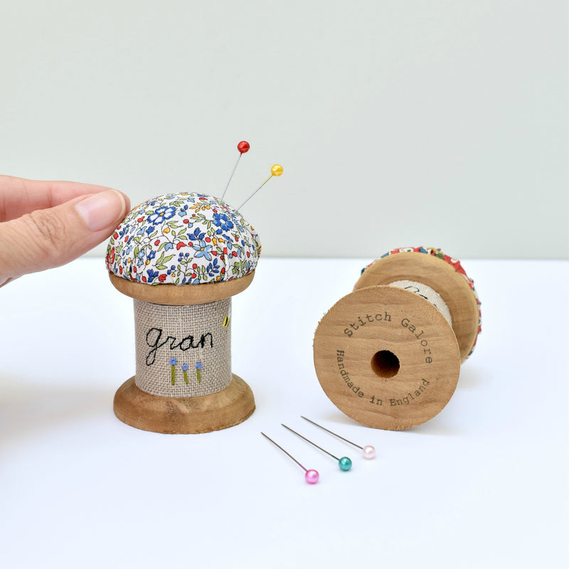Embroidered personalised pincushion, pin holder made using a wooden spool and Liberty fabric handmade by Stitch Galore