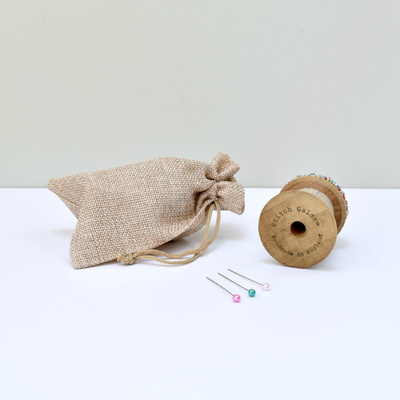 Pincushion, needle holder, sewing gift for made with a wooden bobbin and Liberty fabric handmade by Stitch Galore