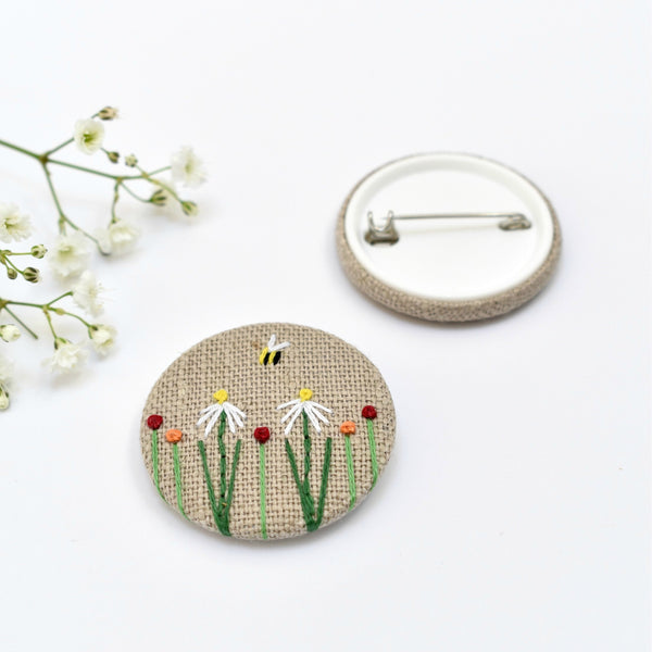 Sewn badge with flowers and bee, flower pin badge handmade by Stitch Galore