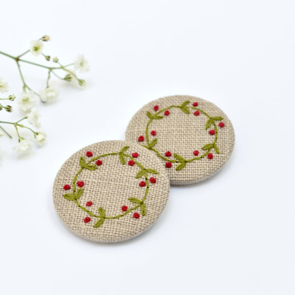 Embroidered holly wreath badge, holly pin badge handmade by Stitch Galore