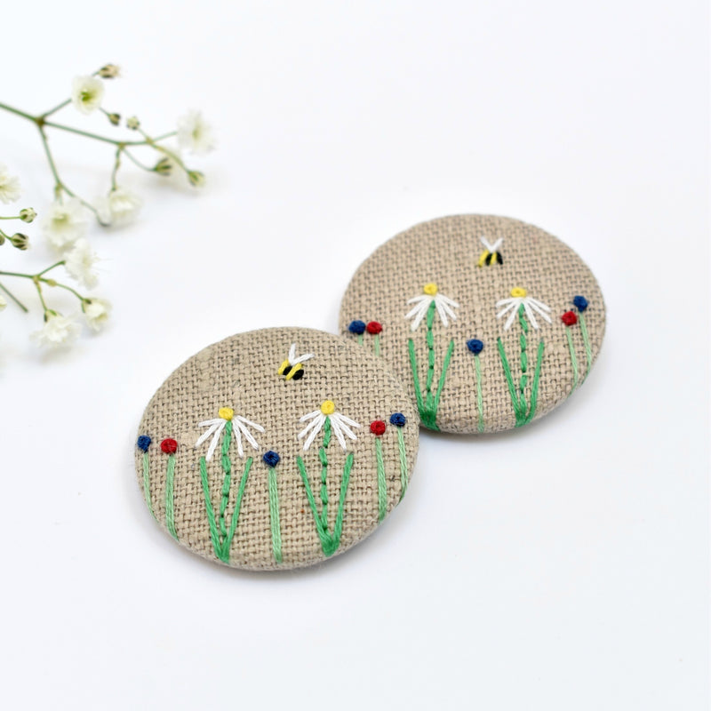Embroidered badge with flowers and bee, floral pin badge handmade by Stitch Galore