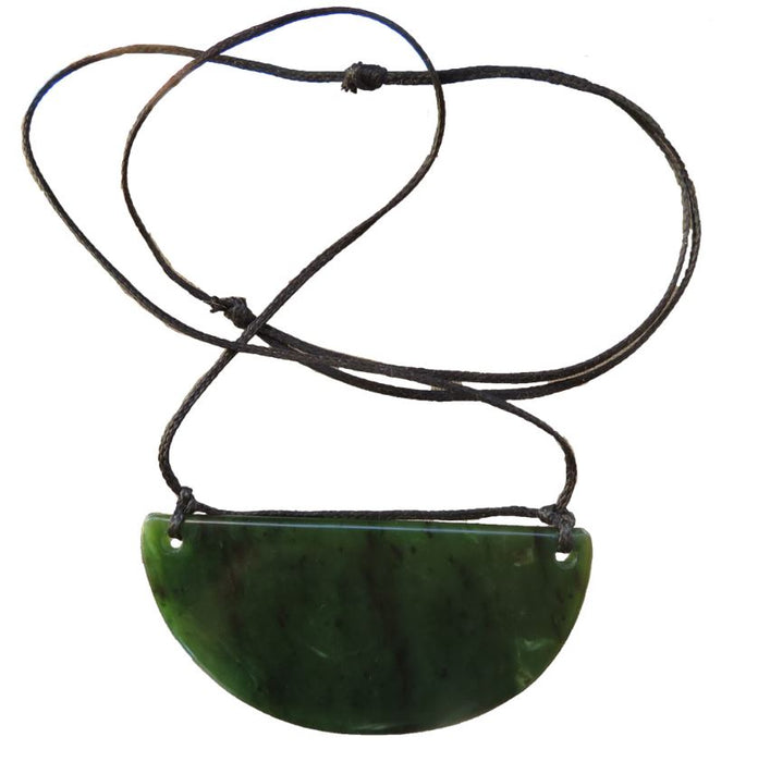 large Greenstone Breastplate and black string chain. Shown against white background