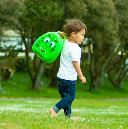 child carrying green portable potty