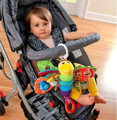 "Photograph of baby in a pram using the ""Freddie the firefly"" mobile toy"