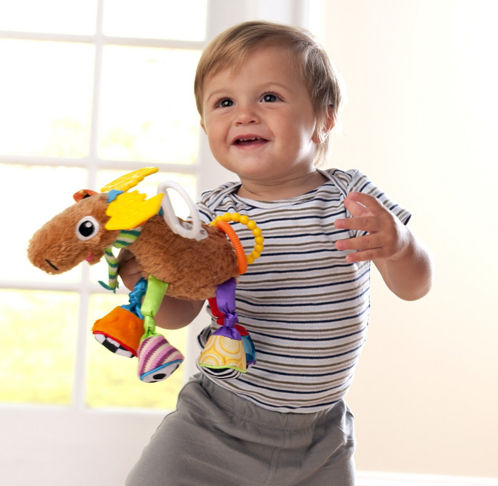 "Child holding the ""Mortimer the Moose"" Lamaze toy"