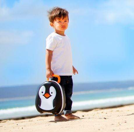 child carrying portable potty with penguin motif