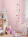 Growth chart wall sticker for girls' room.
