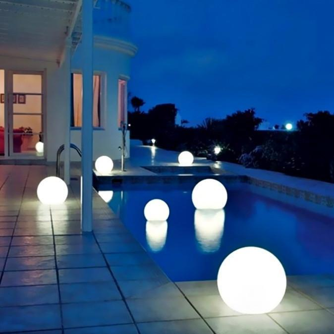 P{Photograph showing many large 60 cm LED spheres at night time
