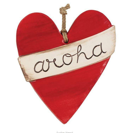 Large red ceramic tile with the word aroha written on it