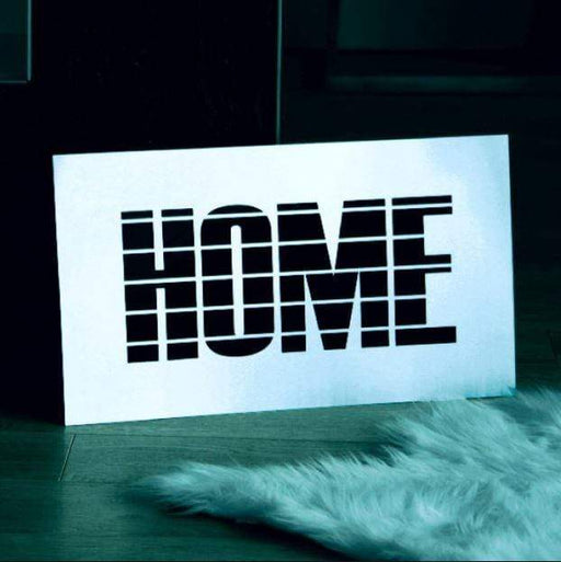 "Steel sign with the word ""home""."