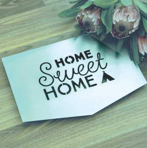 "Small steel sign with the words ""home sweet home""."