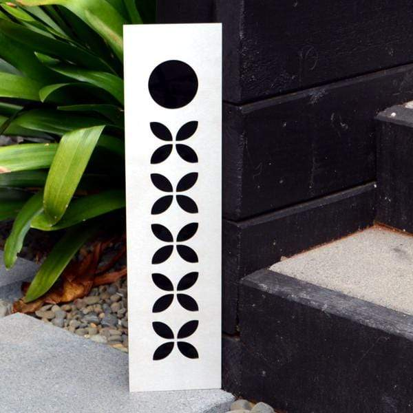 Large steel sign with Pasifika motif.