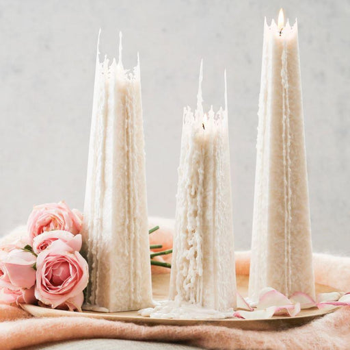 set of 3 deluxe crystalline candles at halfway stage of burn down