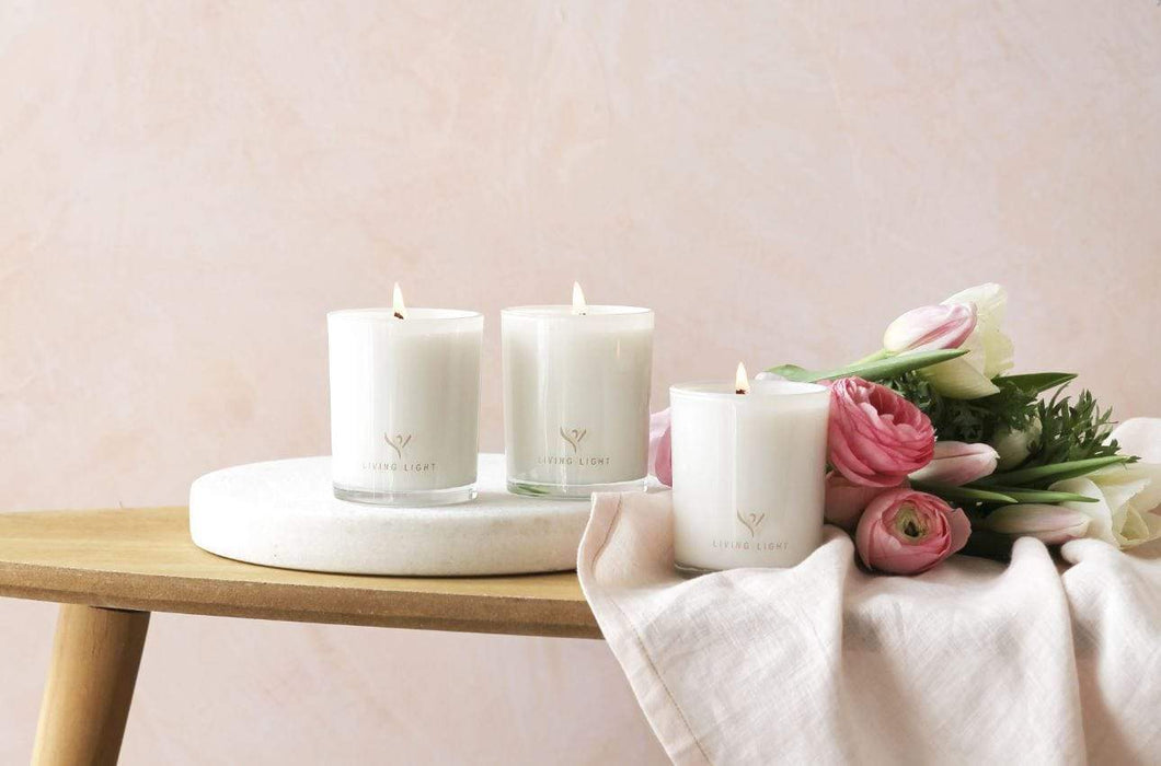 Photograph of three luxury candles in their glass containers
