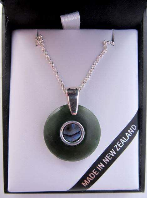 Round Doughnut Shaped Greenstone and Silver Pendant with Paua Inlay. Shown in gift box.