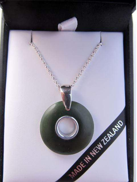 Round Doughnut Shaped Greenstone Pendant with Silver Inlay. Shown in gift box
