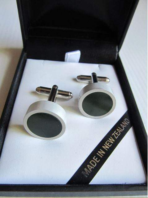 Round greenstone cuff links set in silver alloy. Shown in attractive gift box