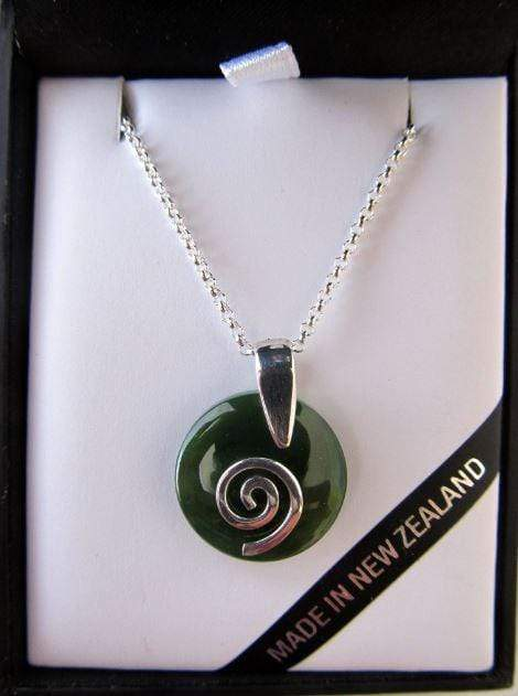 Smooth Round Greenstone Pendant with Silver Koru. Shown here in an attractive gift box