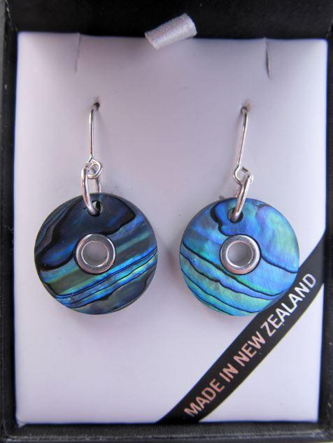 Round doughnut shaped paua earrings with silver inlay shown in gift box