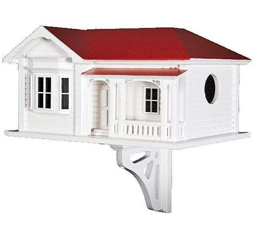 Large birdhouse in the theme of white villa with red roof