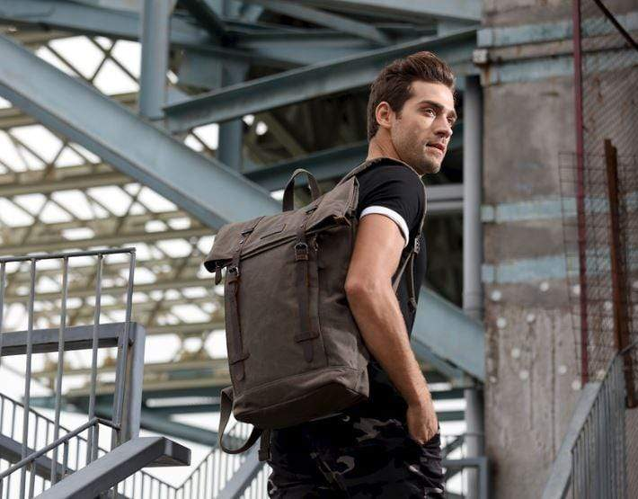 Man wearing edison canvas backpack