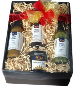 Gourmet gift hamper showing 4 sauces bottles in box