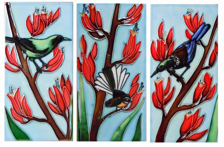 3 ceramic tiles depicting a Bellbird, a Tui and a Fantail in flax flowers