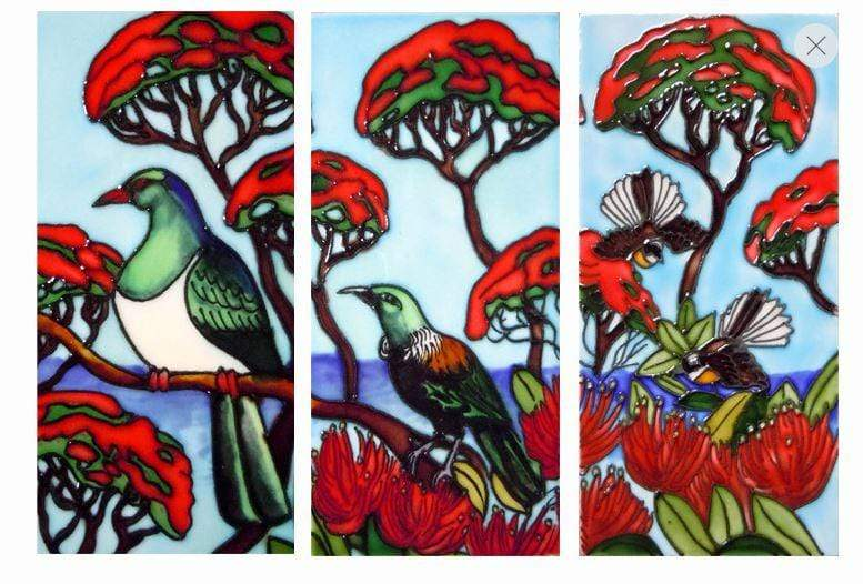 3 ceramic tiles depicting a Kereru a Tui and a Fantail in the branches of Pohutukawa trees