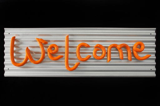 Welcome sign on corrugated metal panel