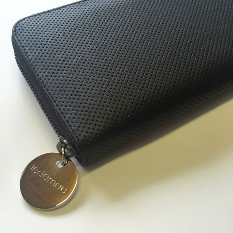 black perforated wallet