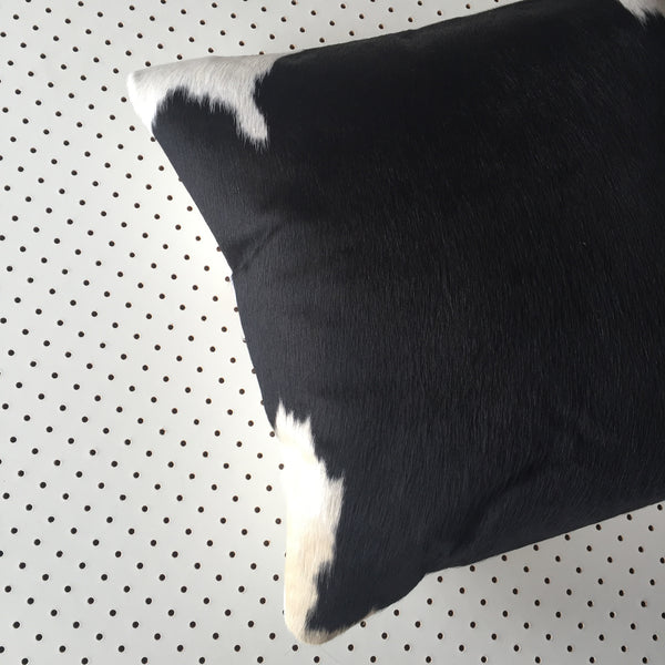 cowhide cushion in black + white hide