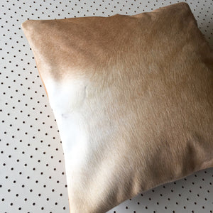 cowhide cushion in tan hide