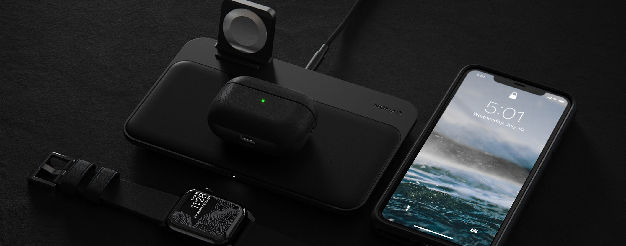 Close up of Active Rugged Case in Black for Apple Airpods on a wooden table